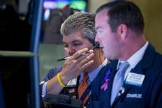 Traders work on the floor of the New York Stock Exchange August 25, 2015.  REUTERS/Brendan McDermid