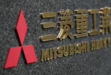 EDF a demandé au japonais Mitsubishi Heavy Industries d'investir dans l'activité réacteurs nucléaires d'Areva, rapporte le journal Nikkei. L'électricien français et le groupe japonais devraient ouvrir des négociations prochainement mais Mitsubishi Heavy industries devrait examiner cette proposition avec prudence, J/Photo d'archives/REUTERS/Yuriko Nakao