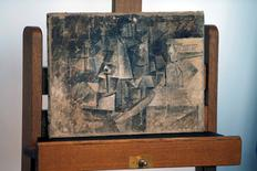 "The stolen $15 million Picasso painting ""La Coiffeuse"" is put on display during a ceremony to mark its return to the Centre Pompidou National Museum of Modern Art, also known as Beaubourg in Paris, France, September 24, 2015. The museum reported ""The Hairdresser"" stolen from its archives in 2001.  REUTERS/Charles Platiau"