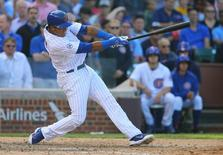 Sep 25, 2015; Chicago, IL, USA; Chicago Cubs shortstop Starlin Castro hits a RBI triple against the Pittsburgh Pirates during the ninth inning at Wrigley Field. Mandatory Credit: Jerry Lai-USA TODAY Sports