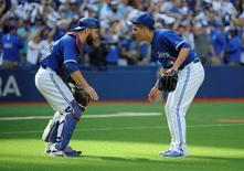 Sep 26, 2015; Toronto, Ontario, CAN; Toronto Blue Jays relief pitcher Roberto Osuna (54) and catcher Russell Martin (55) celebrate a victory over Tampa Bay Rays at Rogers Centre. Jays beat Rays 10 - 8. Mandatory Credit: Peter Llewellyn-USA TODAY Sports