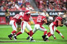 Sep 27, 2015; Glendale, AZ, USA; Arizona Cardinals quarterback Carson Palmer (3) throws a pass against the San Francisco 49ers during the first half at University of Phoenix Stadium. The Cardinals won 47-7. Mandatory Credit: Joe Camporeale-USA TODAY Sports