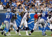 Sep 27, 2015; Detroit, MI, USA; Denver Broncos quarterback Peyton Manning (18) throws the ball during the third quarter against the Detroit Lions at Ford Field. The Broncos win 24-12. Mandatory Credit: Raj Mehta-USA TODAY Sports