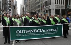 Members of the NBC Universal Lesbian, Gay, Bisexual, Transgender and Straight Ally Employee Alliance group march in the 254th New York City St. Patrick's Day parade up 5th Avenue in the Manhattan borough of New York March 17, 2015. REUTERS/Mike Segar