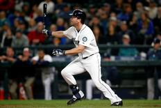 Sep 29, 2015; Seattle, WA, USA; Seattle Mariners shortstop Shawn O'Malley (36) hits a two-RBI-single against the Houston Astros during the eighth inning at Safeco Field. Mandatory Credit: Joe Nicholson-USA TODAY Sports