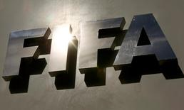The sun is reflected in FIFA's logo in front of its headquarters in Zurich, Switzerland October 5, 2015. REUTERS/Arnd Wiegmann