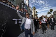 """Actor Sylvester Stallone waves at the premiere of """"Terminator Genisys"""" in Hollywood, California June 28, 2015. The movie opens in the U.S. on July 1.  REUTERS/Mario Anzuoni"""
