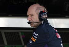 Red Bull Formula One technical chief Adrian Newey speaks on the radio during the second practice session of the Australian F1 Grand Prix at the Albert Park circuit in Melbourne March 14, 2014. REUTERS/Brandon Malone
