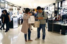 Customers visit the Galeries Lafayette department store in Paris, France, September 23, 2015.  REUTERS/Charles Platiau