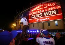 Oct 13, 2015; Chicago, IL, USA; Chicago Cubs fans take pictures outside after game four of the NLDS against the St. Louis Cardinals at Wrigley Field. Mandatory Credit: Jerry Lai-USA TODAY Sports