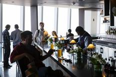Visitors sit down at a restaurant in the newly opened One World Trade Observatory in the Manhattan borough of New York May 29, 2015.  REUTERS/Lucas Jackson