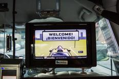 A television screen automatically plays inside of a taxi in New York October 14, 2015. REUTERS/Lucas Jackson