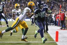 Sep 4, 2014; Seattle, WA, USA; Seattle Seahawks fullback Derrick Coleman (40) beats Green Bay Packers cornerback Tramon Williams (38) to the end zone for a 15-yard touchdown reception during the fourth quarter at CenturyLink Field. Joe Nicholson-USA TODAY Sports