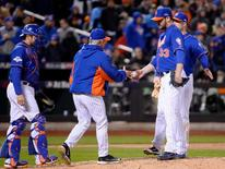 New York Mets starting pitcher Matt Harvey (33) is relieved by manager Terry Collins in the 8th inning against the Chicago Cubs in game one of the NLCS at Citi Field. Robert Deutsch-USA TODAY Sports