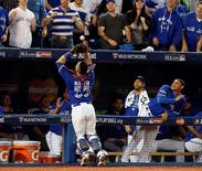 Oct 20, 2015; Toronto, Ontario, CAN; Toronto Blue Jays catcher Russell Martin (55) makes a catch during the ninth inning against the Kansas City Royals in game four of the ALCS at Rogers Centre. Mandatory Credit: Dan Hamilton-USA TODAY Sports