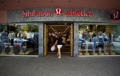 A woman walks into a store of yogawear retailer Lululemon Athletica in downtown Vancouver June 11, 2014. REUTERS/Ben Nelms