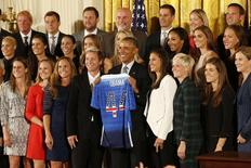 Oct 27, 2015; Washington, DC, USA; President Barack Obama (M) holds an honorary team jersey while posing with members of the 2015 Women's World Cup champion U.S. Women's National Soccer Team at a ceremony honoring their world championship in the East Room at The White House. Mandatory Credit: Geoff Burke-USA TODAY Sports