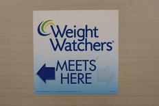 A sign for Weight Watchers is displayed at  office in lower Manhattan, New York October 19, 2015. REUTERS/Brendan McDermid
