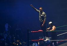 Mercedes Formula One driver Lewis Hamilton of Britain (L) performs with Mexican wrestlers at the Coliseo Arena during a promotional event in Mexico City, October 28, 2015. REUTERS/Henry Romero