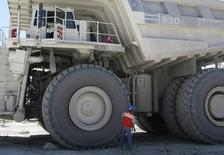 A worker inspects the tyre of a mining truck at the open pit gold mine of Goldcorp in Penasquito September 18, 2012.  REUTERS/Jean Luis Arce