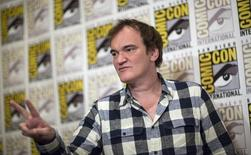 """Director of the movie Quentin Tarantino poses at a press line for """"The Hateful Eight"""" during the 2015 Comic-Con International Convention in San Diego, California July 11, 2015. REUTERS/Mario Anzuoni"""