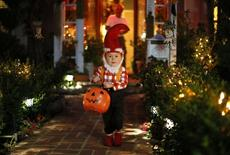 A boy collects candy as he goes trick-or-treating for Halloween in Santa Monica, California, October 31, 2012. REUTERS/Lucy Nicholson