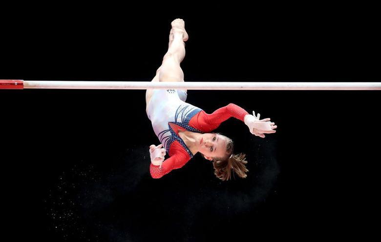Four gymnasts share asymmetric bars gold | Reuters com