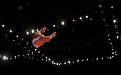 North Korea's Ri Se Gwang competes in the vault during the men's apparatus final at the World Gymnastics Championships at the Hydro arena in Glasgow, Scotland, November 1, 2015. REUTERS/Russell Cheyne
