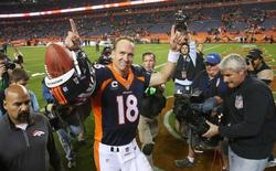 Nov 1, 2015; Denver, CO, USA; Denver Broncos quarterback Peyton Manning (18) celebrates after the game against the Green Bay Packers at Sports Authority Field at Mile High. The Broncos won 29-10. Mandatory Credit: Chris Humphreys-USA TODAY Sports