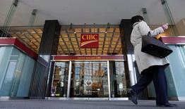 A pedestrian walks past a main branch of CIBC in  Montreal, April 24, 2014.  REUTERS/Christinne Muschi