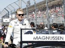 McLaren Formula One driver Kevin Magnussen of Denmark looks on during the drivers parade before the Australian F1 Grand Prix at the Albert Park circuit in Melbourne March 15, 2015.       REUTERS/Mark Dadswell