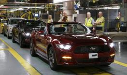An assembly worker drives a 2015 Ford Mustang vehicle off the production line at the Ford Motor Flat Rock Assembly Plant in Flat Rock, Michigan, August 20, 2015.  REUTERS/Rebecca Cook