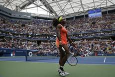 Serena Williams of the U.S. walks on the court as she plays Roberta Vinci of Italy during their women's singles semi-final match at the U.S. Open Championships tennis tournament in New York, September 11, 2015.   REUTERS/Shannon Stapleton