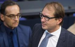 German Transport Minister Alexander Dobrindt (R) attends a session of the German lower house of parliament, the Bundestag, in Berlin, Germany, November 6, 2015.  REUTERS/Hannibal Hanschke