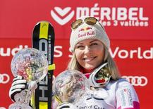 Lindsey Vonn of the U.S. poses with her two Globes after winning the World Cup women's Super G race at the Alpine Skiing World Cup Finals in Meribel, in the French Alps, March 19, 2015.  REUTERS/Robert Pratta