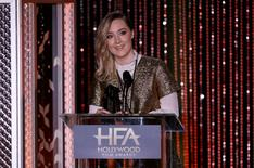"""Actress Saoirse Ronan accepts the New Hollywood Award for her role in the film """"Brooklyn"""" at the Hollywood Film Awards in Beverly Hills, California November 1, 2015.  REUTERS/Mario Anzuoni"""