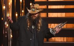 Chris Stapleton accepts the award for Male Vocalist of the Year at the 49th Annual Country Music Association Awards in Nashville, Tennessee November 4, 2015.  REUTERS/Harrison McClary