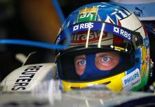 Williams Formula One driver Alexander Wurz of Austria sits in his car during the second free practice session for the European F1 Grand Prix at the Nuerburgring racing circuit in western Germany July 20, 2007. REUTERS/Alex Grimm