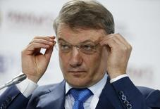 """CEO of Sberbank German Gref adjusts his glasses as he attends the Gaidar Forum 2015 """"Russia and the World: New Dimensions"""" in Moscow, January 14, 2015. REUTERS/Sergei Karpukhin (RUSSIA - Tags: BUSINESS HEADSHOT)"""