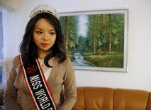 Miss World Canada Anastasia Lin poses with her crown before an interview at her home in Toronto, Ontario November 10, 2015. REUTERS/Chris Helgren