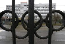 """A view through a fence, decorated with the Olympic rings, shows a building of the federal state budgetary institution """"Federal scientific centre of physical culture and sports"""", which houses a laboratory accredited by the World Anti-Doping Agency (WADA), in Moscow, Russia, November 11, 2015. REUTERS/Sergei Karpukhin"""