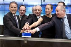 Robert J. Coury, Chairman and Chief Executive Officer of Mylan (L) participates in a bell ringing ceremony with officials at the Tel Aviv Stock Exchange, Israel November 4, 2015. Mylan NV's $26 billion hostile bid for Perrigo Co Plc collapsed on November 13, 2015 after the Netherlands-based drugmaker failed to secure at least half of Perrigo's outstanding shares in the tender offer.  REUTERS/Nir Elias/Files