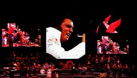 A live band backs up a virtual Elvis during a memorial concert of Elvis footage in Memphis, Tennessee, August 16, 2007. REUTERS/Lucas Jackson