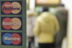 A sign with a logo of MasterCard is seen on the door of a branch of Sberbank in Stavropol January 13, 2015.  REUTERS/Eduard Korniyenko