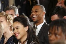 Victor Cruz of the NFL's New York Giants smiles as U.S. President Barack Obama mentions him in his remarks at the 2015 White House Science Fair at the White House in Washington, March 23, 2015.  REUTERS/Jonathan Ernst - RTR4UJE6
