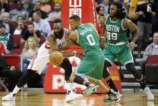 Nov 16, 2015; Houston, TX, USA; Houston Rockets guard James Harden (13) and Boston Celtics guard Avery Bradley (0) fight for a loose ball in the second quarter at Toyota Center. Mandatory Credit: Thomas B. Shea-USA TODAY Sports