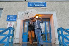 Richard Dowlin (L), 35, and Cormac Gollogly, 35, leave the South Clonmel Community Care Centre in County Tipperary after getting married, November 17, 2015.  REUTERS/Cathal McNaughton