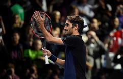 Men's Singles - Roger Federer of Switzerland celebrates winning his match against Novak Djokovic of Serbia Reuters / Toby Melville Livepic