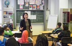 Cordula Heckmann, principal of Berlin's Ruetli Campus, speakes to her pupils in Berlin, Germany, November 9, 2015. REUTERS/Hannibal Hanschke