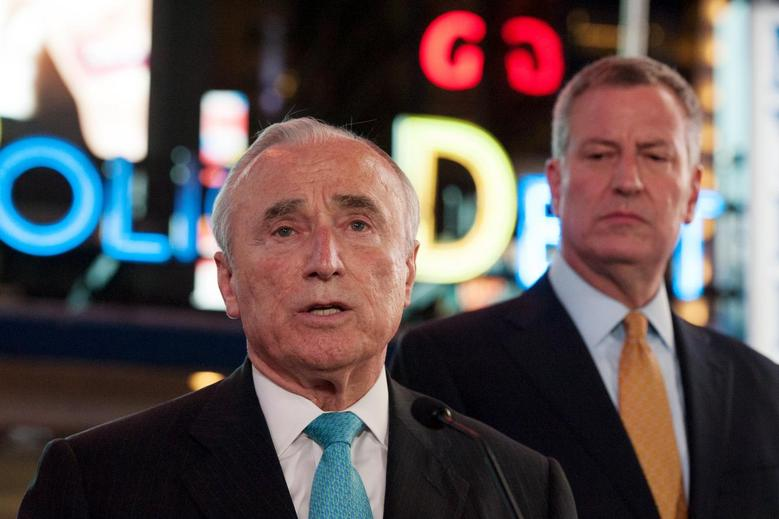 New York City Police Commissioner William Bratton (C) and New York City Mayor Bill de Blasio (R) deliver remarks at a news conference in Times Square in the Manhattan borough in New York, November 18, 2015. REUTERS/Stephanie Keith
